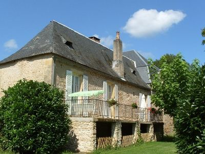 Photo for Charming cottage in the heart of the black perigord with swimming pool