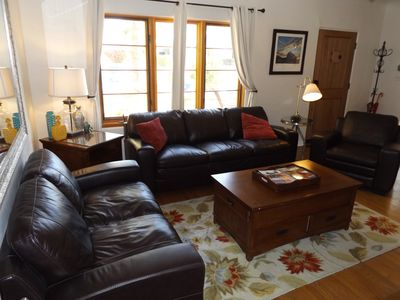 Seating in the living room including the leather sleeper couch