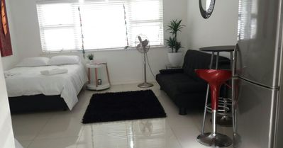 Photo for Neat bachelor pad, small but cozy, across the road from beach in Moullie Point