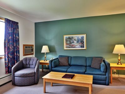 Photo for Deluxe one bedroom suite located on the 2nd floor with outdoor heated pool