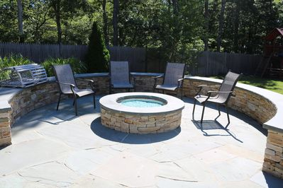 Enjoy the gas firepit after a long day at the beach.