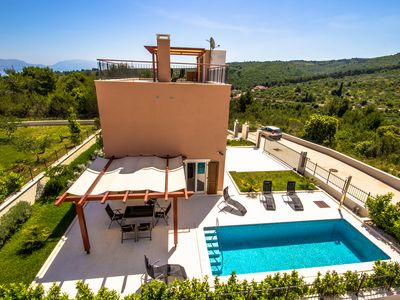 Photo for Enjoy your vacation in dreaming villa Splitska 1 with pool and sea view