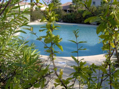 Photo for House with WIFI and air conditioning in residence with large swimming pool, near beach