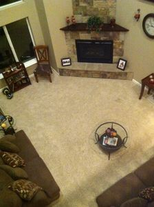 View of living room from the above bridgeway on second floor