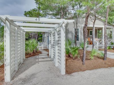 Photo for Elegant home w/ carriage house, outdoor kitchen, shared pool & easy beach access