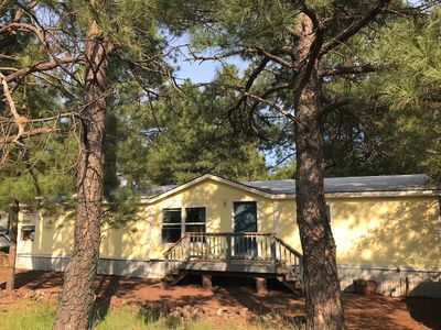 Photo for Play in the Pines. Comfortable 3 bedroom home on a large lot in the quiet pines.