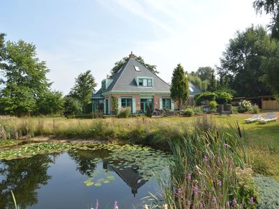 Photo for Lavishly appointed group accommodation in a quiet location with distant views and a swimming pond