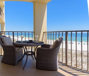 Comfortable bistro set.  All balcony furniture is cushioned, even the chaises.