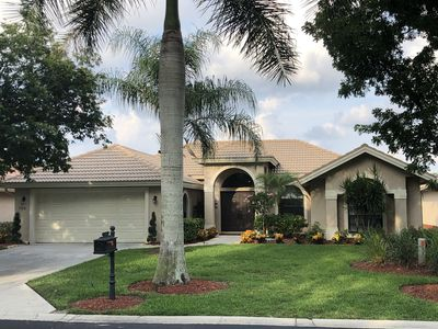 Photo for Gorgeous 5 ⭐️, 4 BR/3 FB home. Stunning lakefront view from saltwater spa/pool☀️🌴