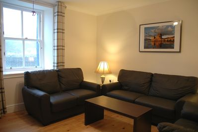 Lounge with leather sofas seating for 6, view to harbour