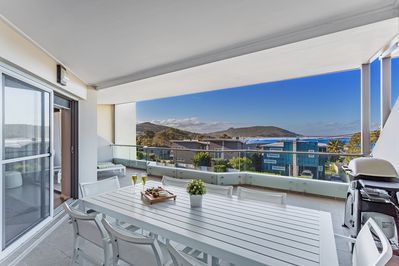 Expansive balcony with beach and ocean views over Fingal Bay