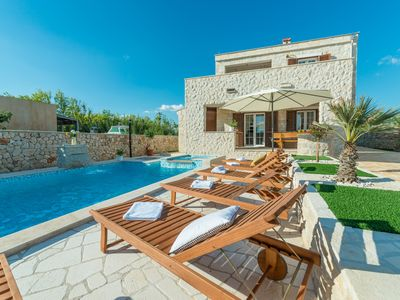 Photo for Stone villa with heated pool, jacuzzi, 500 meters from the sandy beach. sea ​​view