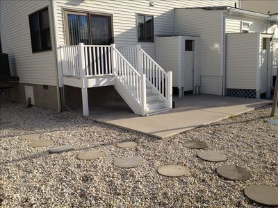 Private Backyard Area. Includes Patio Furniture and Grill.