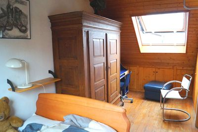 cosy bedroom with wooden furniture