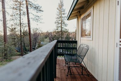 Front porch swing, perfect for watching the sunset.
