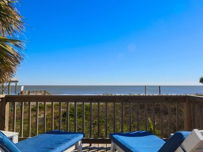 Photo for Watch Pelicans Soar Above the Beach from the Screened Porch of this Elevated Beachfront Bungalow.