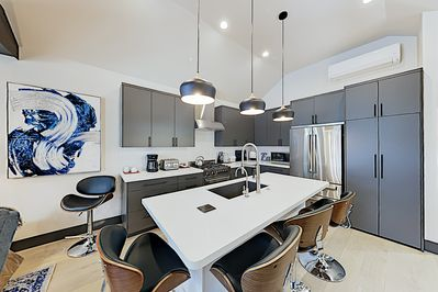 Kitchen - Fix delicious vacation meals in a gourmet kitchen outfitted with stainless steel Bertazzoni appliances.