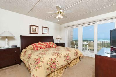 The master bedroom has a king-size bed and an amazing ocean view!