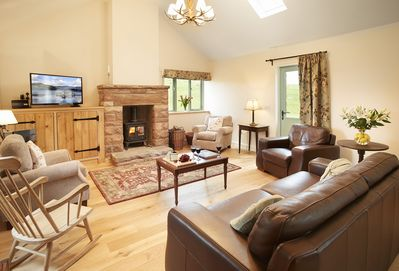 Ground floor: Open plan sitting room with cast iron wood burning stove