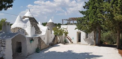 Photo for Fabiola turquoise trullo, with swimming pool, pine wood and olive trees