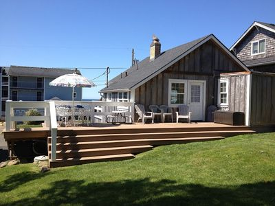 Large grass backyard with large new deck. BBQ and lots of comfortable seating.