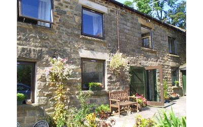 Photo for Stunning cottage with hot tub in the Peak district yet only 14 minutes