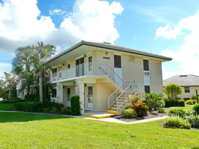 Photo for Tranquil inland condo w/ heated pool just a short walk from the beach