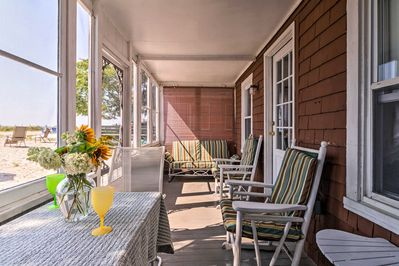 This 3-bedroom, 1.5-bath getaway features a fully furnished screened porch.