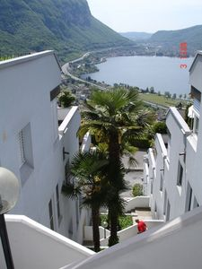 Photo for Apartment overlooking Lake Lugano w. heated pool, stunning view from balcony