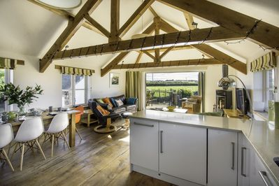The Hayloft kitchen diner with bifold doors out to the garden.