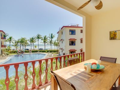 Photo for Elegant oceanfront condo w/ ocean views & shared pool - steps from the beach!