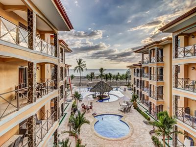 Photo for Modern condo in oceanfront complex w/ ocean view & shared pool - walk to beach!