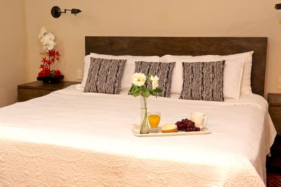 """The master suite is cozy with a SUPER comfortable king size bed."" Zoe USA"