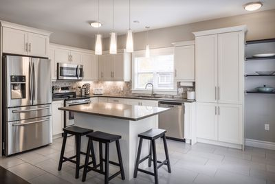 Modern kitchen with stainless steel appliances and an ice maker.