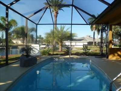 Gorgeous Heated Pool with waterfront view and lucious landscaping