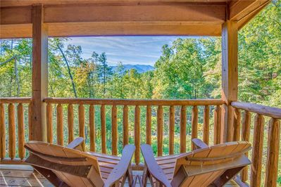 What a view! - Rocky Top Lookout's 2 covered decks offer spectacular views of Mount LeConte and old-growth forests—and plenty of chairs so that everyone can relish nature's grandeur.
