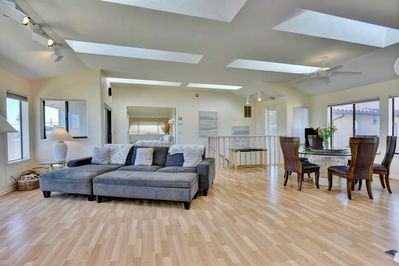 Spacious reverse open floor plan loaded with sky lights