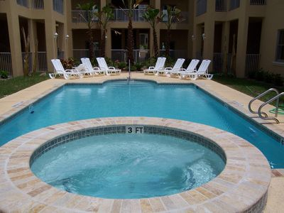 Photo for Near Beach condo sleeps  6 with pool & hot tub
