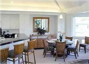 Breakfast bar and dining room with great open design and vaulted ceiling.