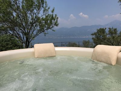 Photo for Rustic with lake view and heated Jacuzzi