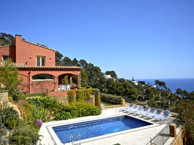 Photo for The villa it set half way up the hill on the northern side of Aigua Blava bay. The quiet b