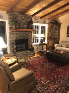 Living Room with stack stone fireplace.