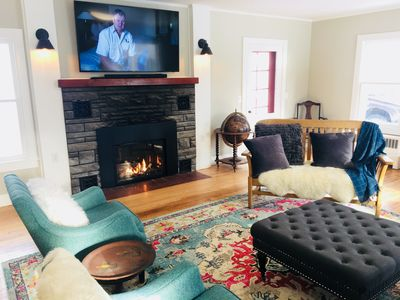 """Living Room with gas fireplace and 65"""" smart/cable TV"""