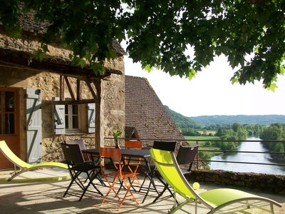 Terrace and sun lounges with view  to the Dordogne 's river