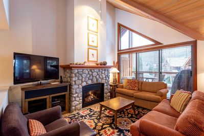 Living area with river rock gas fireplace