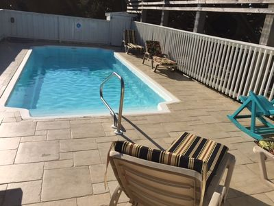 Large private outdoor pool faces south, perfect for swimming and sunbathing.