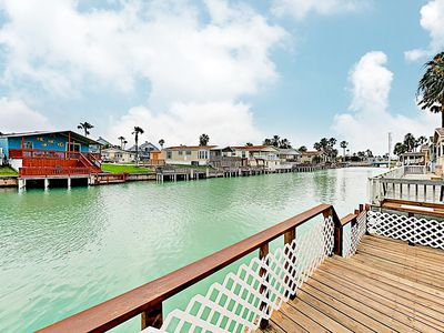 Photo for Waterfront Home w/Expansive Deck, Channel Access & 2 Pools - 5 Miles to Beach