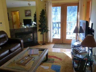 Familyroom with gas fireplace and balcony