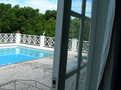 Photo for Villa with large pool, screened terrace overlooking Caribbean.
