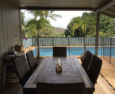 Table for six with removable pool security fence for toddler guests.